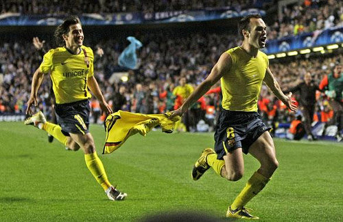Barcelona's Andres Iniesta, right, celebrates after scoring his sides equalising goal during their Champions League semifinal second leg soccer match against Chelsea at Chelsea's Stamford Bridge stadium in London, Wednesday, May, 6, 2009. (AP Photo/ Matt Dunham)